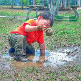 While at the dog park minding the dog, our little one found a puddle of mud to play in