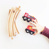 Thief! :) || Child's hand reaches out to steal toy trains from white background.