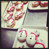 Happy snowmen doughnuts await their deaths.