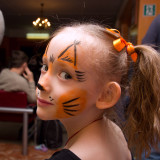 portrait of a girl in body art for squirrel Christmas display