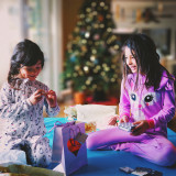 Children opening presents on Christmas Day.