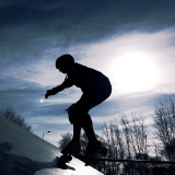 Roller derby training at the local skate park. Capturing great silhouettes having the sun behind the skater.