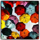 Getafe, Madrid Spain, A lot of umbrellas hunging in the principal street just for sun shelter. The colors takes the shades
