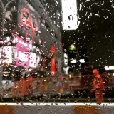 Road worker in Times Square on a rainy day. New York, NY