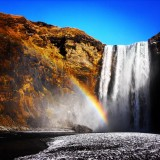 A stunning winters day at Skogafoss waterfall in Iceland