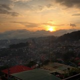 Incoming typhoon in Baguio City covers the horizon while the sun sets
