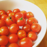 Red cherry tomatoes in bowl