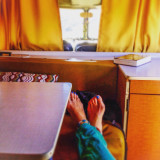 Relaxing, kicking back, feet up on the seat of a 1967 VW