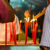 Devotees lighting their incense (joss) sticks to pray for an auspicious start to the Year of the Monkey at Lian Shan Shuang Lin Monastery temple in Singapore.
