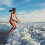 Girl jumping over waves