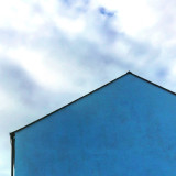 Minimal blue house in Carlingford, Republic of Ireland.