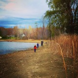 The water has seeped into the greater lake and the beach has become a dry playground for children and frogs.