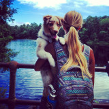 Girl hiking with puppy
