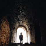 Man silhouette in the old castle
