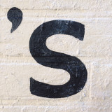 Apostrophe S painted on wall