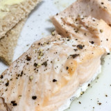 Baked Salmon steak with black pepper and buttered bread