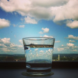 My cup is filled with clouds and blue sky.