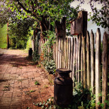 Vintage picket fence and stone walkway in historical Zoar Ohio