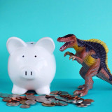Dinosaur and his piggy bank