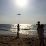 Watching airplanes touch down at the beach