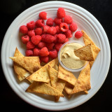 Homemade tortilla chips, hummus, and raspberries. Yummy:)