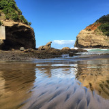 Bethell's beach in New Zealand- where a lot of Xena scenes were filmed