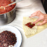 Making tamales with chile rojo and raisins.