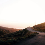 Golden hour sunset and winding hilltop coastal road at Lost Coast California