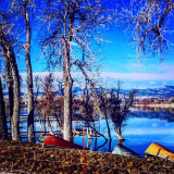 Colorful canoes by the lake in Longmont, Colorado.