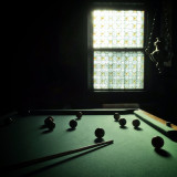 Light and shadow. Pool table and window.