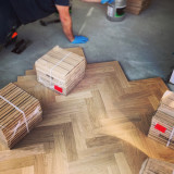 Wood parquet flooring being laid