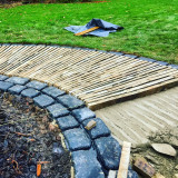 New stone paving being laid
