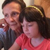 Grandmother and granddaughter sharing a moment.