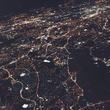 aerial view of london, flying in at night