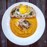 Soul Soup - Butternut squash soup with fennel, onions, carrots, yams, fresh sage, nutmeg, cinnamon, red chili flakes, garlic, chicken broth, and bacon. Black olive bread with olive oil and egg yoke on the side.