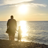 Family enjoys the glow on the lake during the golden hour before sunset (Lake Ontario)