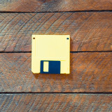 Yellow floppy disk as used in the 1980s and 1990s