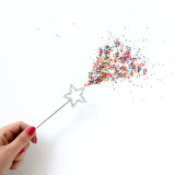 Magical! Sprinkles coming from a magic wand.