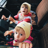 small children in old car
