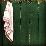 Striped towel draped over picket fence