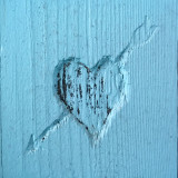 Blue heart scratched into wood