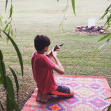 Boy with B.B. gun under the willow tree