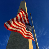 American flag with Washington Monument