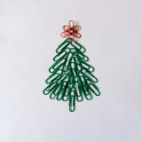 Christmas tree from paper clips on a white background