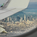 The city of Los Angeles can be seen from an airplane window.