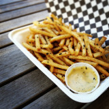 Seasoned french fries from a food cart