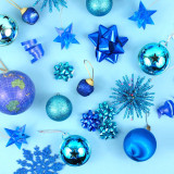I'm dreaming of a blue Christmas. Festive blue Christmas ornaments on a blue background.