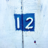 Number 12 on a wooden gate