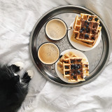 Breakfast waffles with coffee in bed