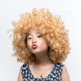 Wearing a blonde wig and funny facial expression Asian girl